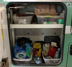 Photo of a compartment with various supplies.
