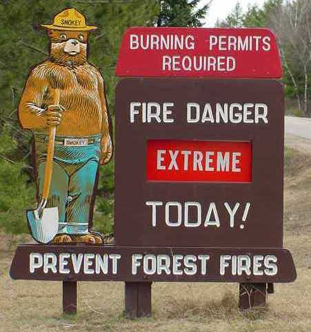 Smokey Bear sign showing extreme fire warning.