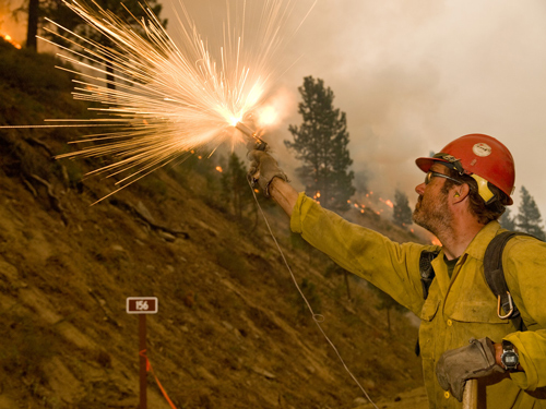 picture of firefighter using a flare launcher