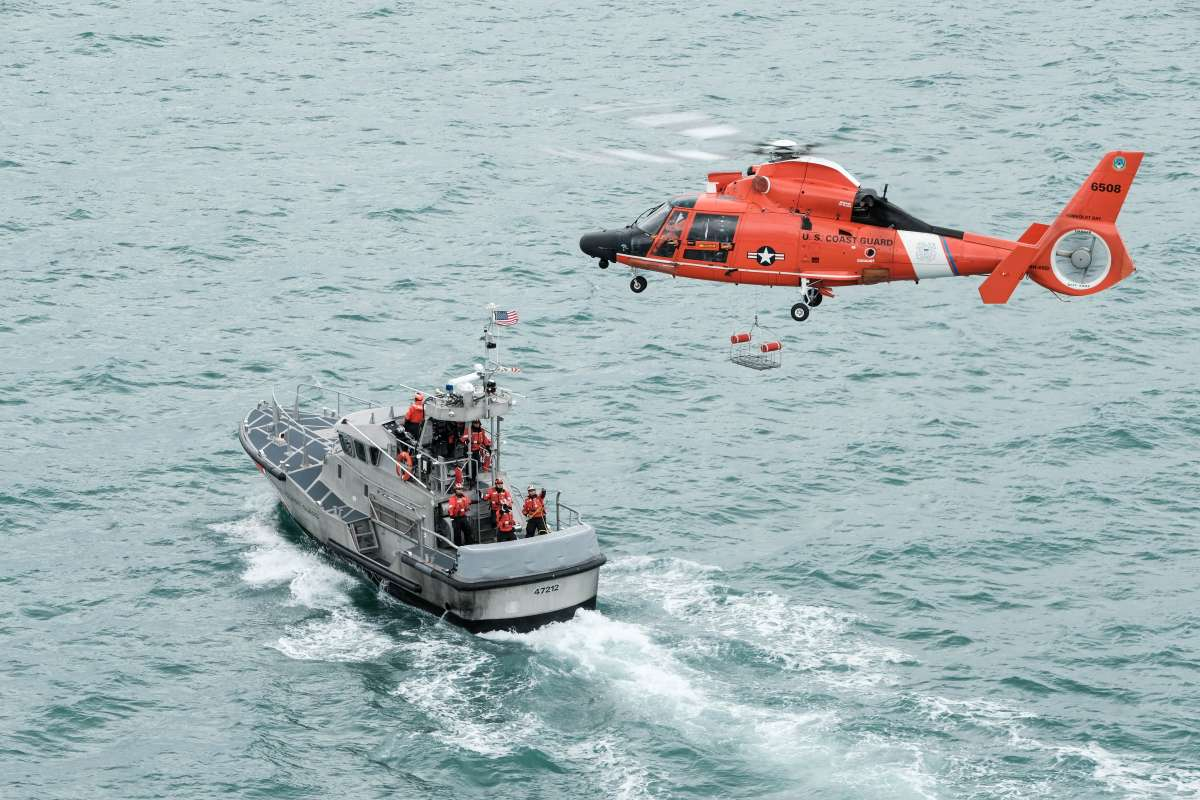 Photo of Coast Guard MH65D Helicopter and boat