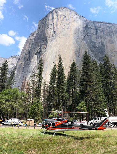Photo of El Capitan with a temporary helibase located in foreground. Decorative.