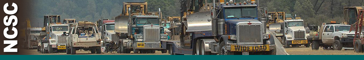NCSC header graphic. Photo of trucks loaded with heavy equipment lined up in dirt parking area. Decorative.