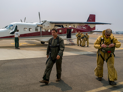 Photo of smokejumpers and plane. Decorative.