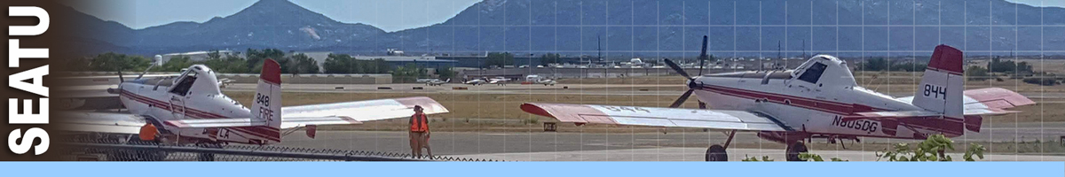 SEATU header graphic. Decorative. Two single engine airtankers lined up on tarmac while fixed wing parking tender monitors area.
