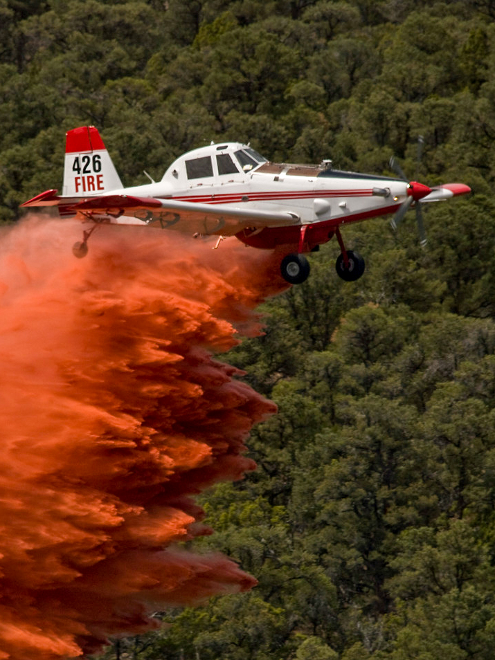 A single engine airtanker drops a load of retardant.