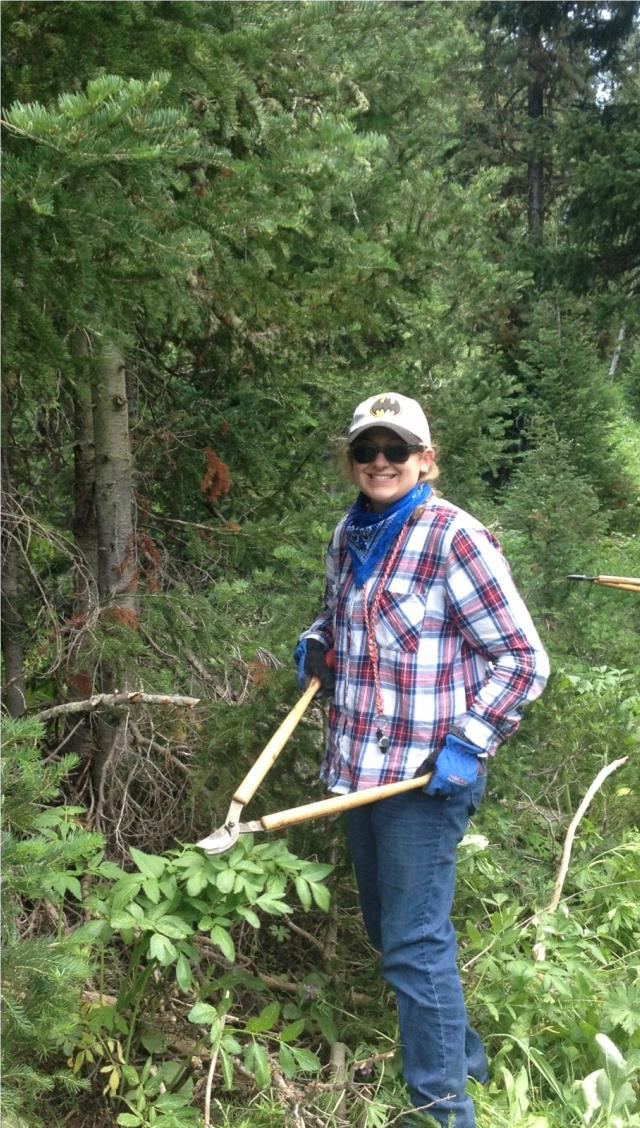 Picture of woman clearing brush