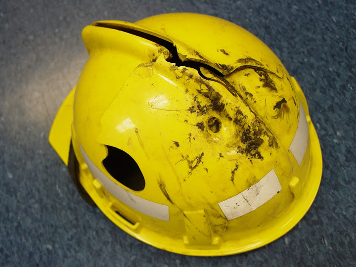 Hardhat damaged by falling material...Broke apart and absorbed some energy as designed
