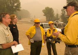 photo of iarr talking with a group of firefighters and managers