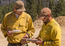 photo of ordm reviewing paperwork with team member