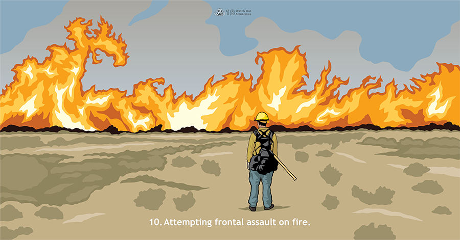 10. Attempting frontal assault on fire. Large, orange flames move towards a lone firefighter holding a shovel and standing in grass and brush.
