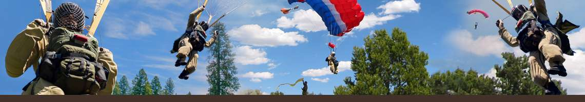 Decorative banner. Photo of five smoke jumpers airborne