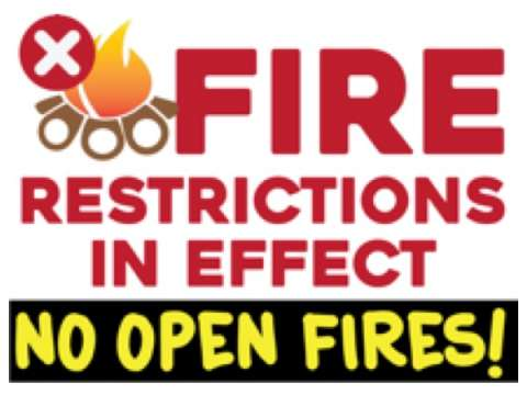 Fire Restrictions in effect: No Open Fires; fire prohibited symbol with flame and logs