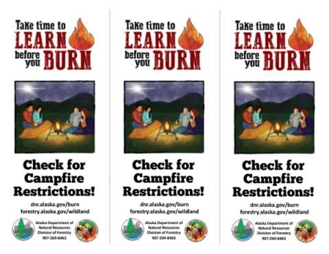 Alaksa Learn Before You Burn Rack card with campers by a lantern light