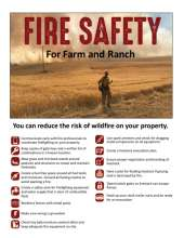 Firefighter looking at a grass fire with fire prevention tips.