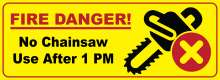 "Bright yellow background with red border; ""Fire Danger"" text; chainsaw icon with red X in circle; ""No chainsaw use after 1 PM text"