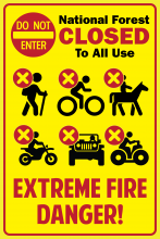 "Do not enter sign; ""National Forest Closed to all use"" text; hiking icon with red X in circle; biking icon with red X in circle; horseback riding icon with red X in circle; ATV icon with red X in circle; vehicle icon with red X in circle; quad icon with red X in circle; ""Extreme Fire Danger"" text"