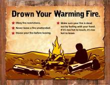 Drown your warming fire with person seated on a log by a warming fire