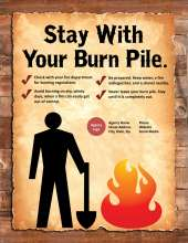 Stay with your burn pile. Figure with shovel standing next to a burn pile.
