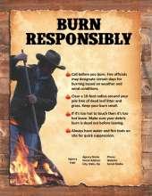 Man with rake tending burn pile
