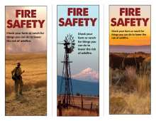 Fire Safety For Farm and Ranch rack card with photos of firefighter at grass fire, Windmill with mountains, cattle. on range
