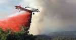 Photo of a single engine air tanker making a retardant drop.