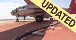 Picture of an airtanker on the RAMP getting refilled with retardant with updated banner.