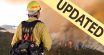 Image of a firefighter as a lookout up on a ridge overseeing the fire across the valley updated.