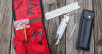 Photo of a complete belt weather kit laid out on a table.