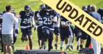 Photo of Seattle Seahawks team doing drills with updated banner in upper left corner.
