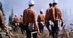Historic image of firefighters heading to work on the fireline.