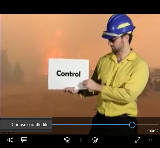 Screen shot showing closed captioning icon with Choose subtitle file instruction
