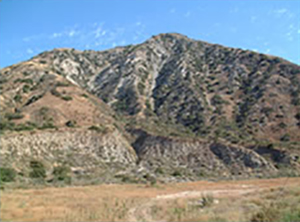 Looking at the chimney canyon and fatality site from Pacoima Dam Road. Highest point visible on the ridge is Stand 3.