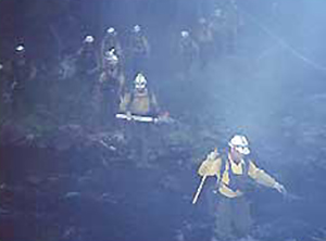 Entiat Hotshot Crew, during early morning hours on July 10, 2001, crossing the Chewuch River to work on spot fires after completing hand line construction on west side of river.