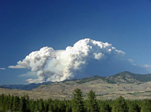 View from Winthrop of the Thirtymile Fire column during the entrapment. Note split column and lenticular clouds developing between the two columns.